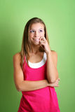 Cheeky woman. Beauty portrait of a happy young cheeky woman is thinking stock image