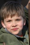 Cheeky young boy. Portrait of cheeky young boy pulling funny face royalty free stock photo