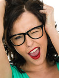 Cheeky Young Woman Winking and Shouting Out. Wearing Glasses, with her mouth open being silly or playful with funny facial expressions, Against A White royalty free stock photo