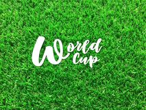 White text `World cup` on green football filed royalty free stock image