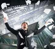 Cheer for job satisfaction. In the office businessman exults throwing sheets Royalty Free Stock Photo