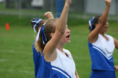 Cheer Leader Cheering. Football Cheer leader cheering at football game stock photo