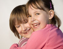 Cheer and love of sisters. Emotion Royalty Free Stock Images