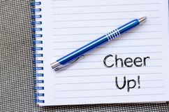 Cheer up concept on notebook. Cheer up text concept write on notebook Stock Photography