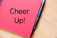 Cheer up concept on notebook. Cheer up text concept write on notebook Stock Image