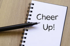 Cheer up concept on notebook. Cheer up text concept write on notebook Royalty Free Stock Image