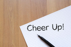 Cheer up concept on notebook. Cheer up text concept write on notebook Stock Photo