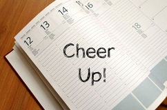 Cheer up concept on notebook. Cheer up text concept write on notebook Royalty Free Stock Images