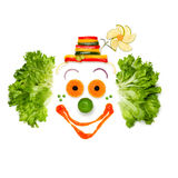 Cheer your life like your food does. A portrait of joyful clown made of vegetables and sauce Royalty Free Stock Image