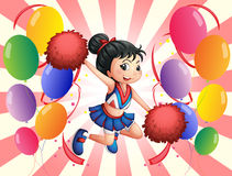 A cheerdancer in the middle of the balloons Royalty Free Stock Image