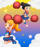 Cheerdancers with red pompoms. Illustration of the cheerdancers with red pompoms Royalty Free Stock Photography