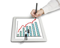 Cheered businessman with growth trend arrow and chart on tablet Royalty Free Stock Photography