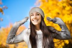 Cheerfu woman on a autumn sky background Stock Photo