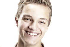 Cheerful 16 year old boy. A Cheerful 16 year old boy on a white background stock images