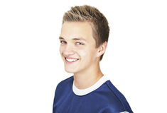 Cheerful 16 year old boy. A Cheerful 16 year old boy on a white background royalty free stock photo