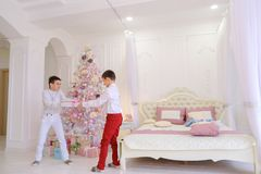 Childish pranks of two brothers of twins and innocent fight for Royalty Free Stock Photography