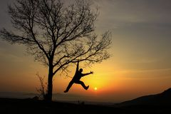 Active, dynamic and energetic movements in nature. Cheerful, active, energetic and enthusiastic person stock photography