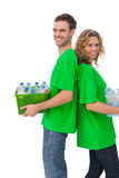 Cheerful activists holding box of recyclables and standing back Royalty Free Stock Photo