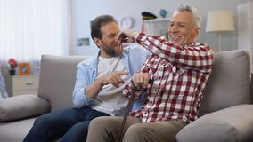 Cheerful adult males sharing memories father and son joking and having good time. Stock footage stock footage