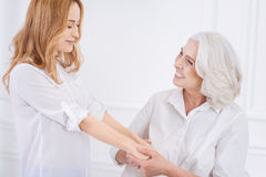 Cheerful adult woman and her mother resting at home Stock Image