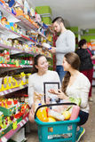 Cheerful adults choosing tinned food Stock Image