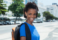 Cheerful african american female student in the city Stock Photos