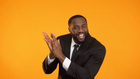 Cheerful african-american man dancing and clutching hands, promo campaign stock video