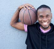 Cheerful african american man holding basketball Stock Photo