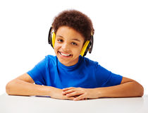 Cheerful African American school boy with headset royalty free stock image
