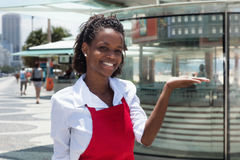 Cheerful african american waitress in front of the restaurant Stock Images