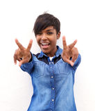 Cheerful african american woman with peace hand sign. Portrait of a cheerful african american woman with peace hand sign royalty free stock images
