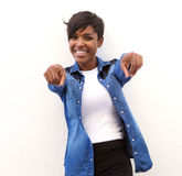 Cheerful african american woman pointing fingers Royalty Free Stock Image
