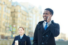 Cheerful African Businessman Making Phone call stock photos