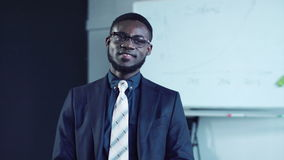 Cheerful african businessman smile and look at camera stock video footage