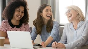 Cheerful african and caucasian businesswomen laughing having fun at workplace. Cheerful african and caucasian businesswomen laughing having fun good relations royalty free stock photography