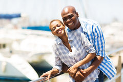 Cheerful african couple harbor Stock Photos