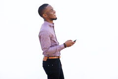 Cheerful african man with a cell phone Royalty Free Stock Photography