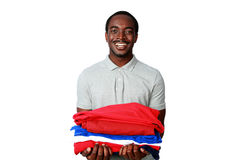 Cheerful african man holding his clothes Royalty Free Stock Image