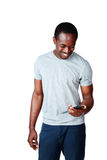 Cheerful african man using smartphone Royalty Free Stock Photography