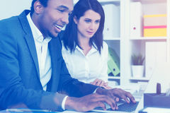 Cheerful African man working, woman watching Royalty Free Stock Photos