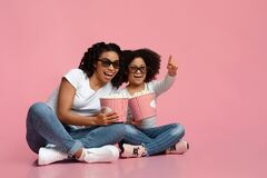 Cheerful African Mom And Daughter In 3d Glasses With Popcorn Buckets