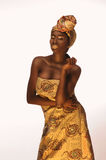 Cheerful african woman with creative gold make–up and turban Stock Photography