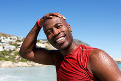 Cheerful afro african guy at the beach after swim Royalty Free Stock Images