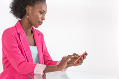 Cheerful  afro american business woman talking on cell phone Royalty Free Stock Images