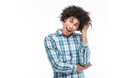 Cheerful afro american man with curly hair looking at camera Royalty Free Stock Photography