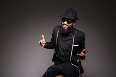 Cheerful afro american man in stylish cloth and glasses Royalty Free Stock Photography