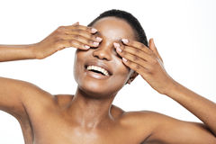Cheerful afro american woman covering her eyes Royalty Free Stock Photography