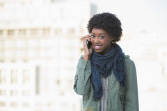 Cheerful afro model on the phone Stock Images