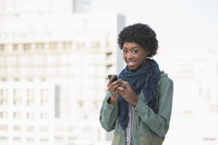 Cheerful afro model texting Royalty Free Stock Image