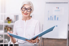 Cheerful aged businesswoman enjoying her working hours Royalty Free Stock Images